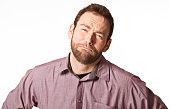 Worried handsome man in blueberry shirt.
