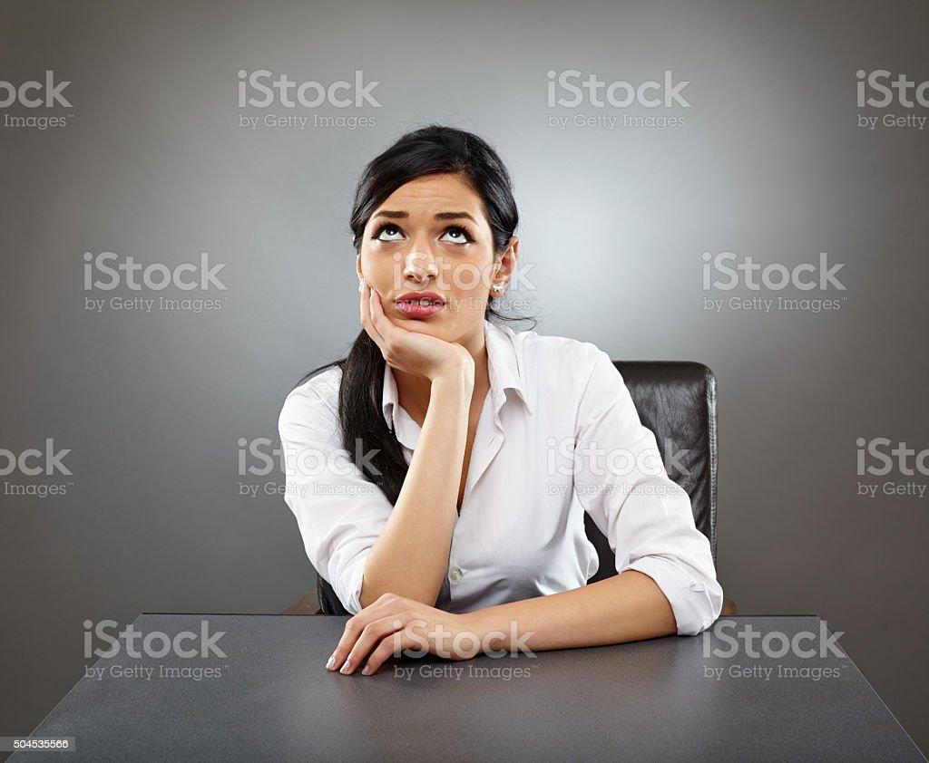 Worried hispanic business lady stock photo