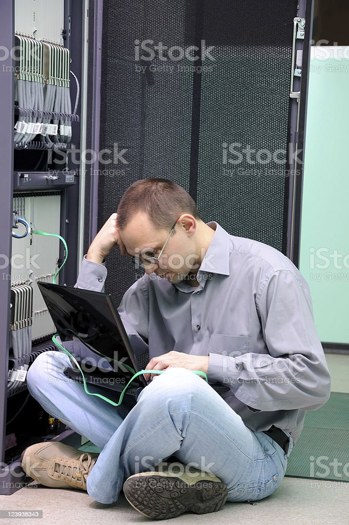 Worried IT technician stock photo