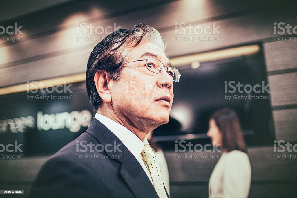 Worried Japanese businessman stock photo