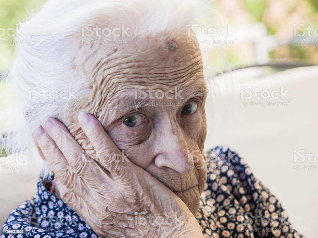 Worried look of a senior woman stock photo
