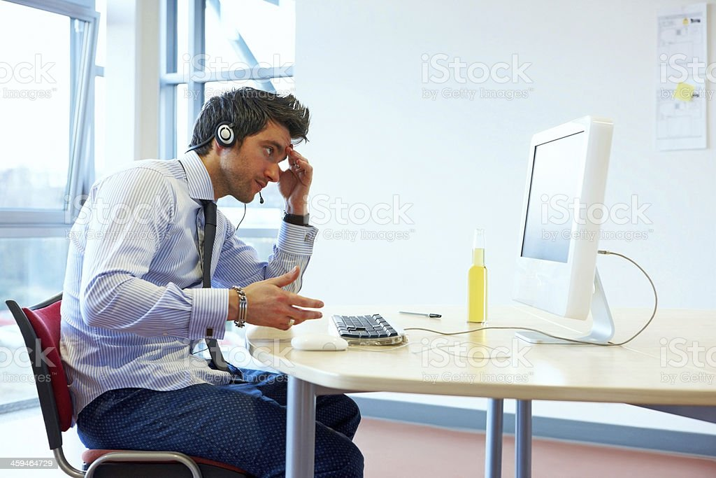 Worried looking male call center executive stock photo