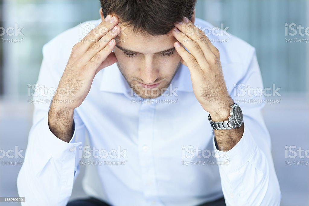 Worried man, hands on forehead stock photo