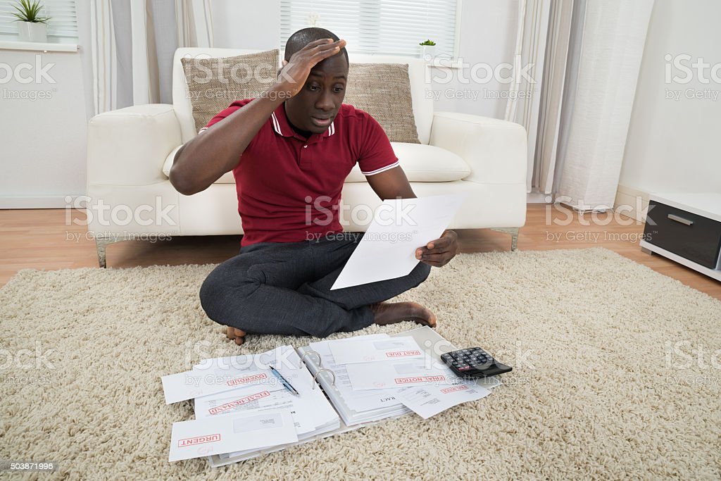 Worried Man Looking At Document stock photo