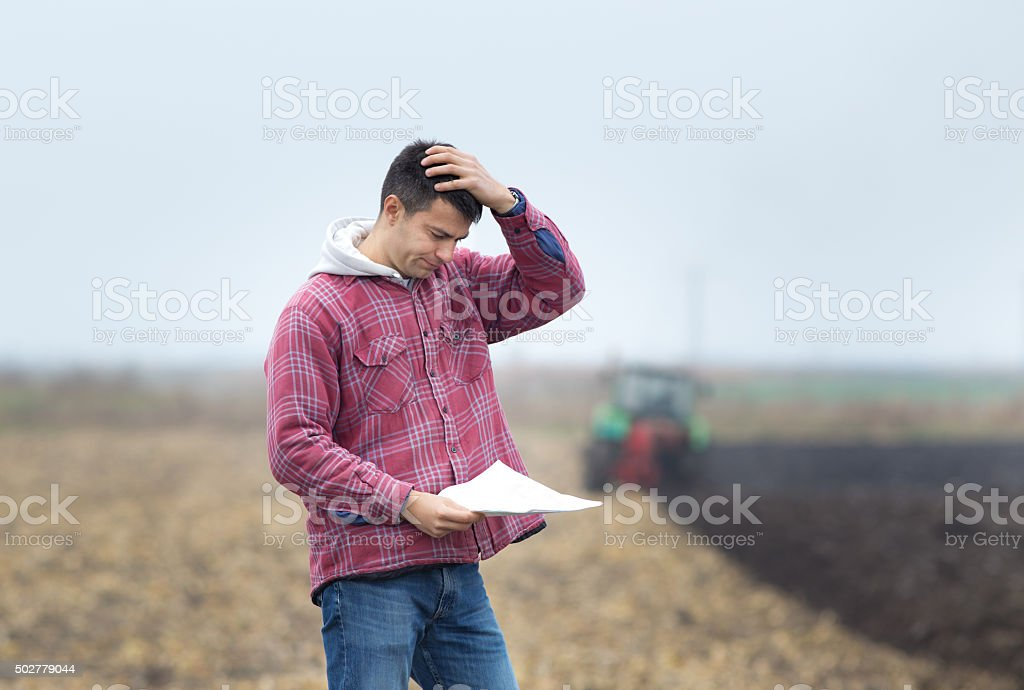 Worried man on the field stock photo