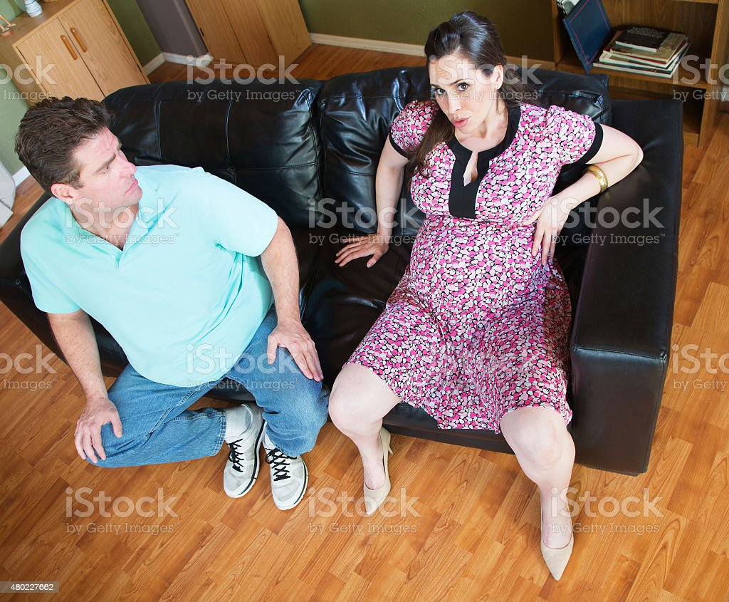 Worried Man with Pregnant Woman stock photo