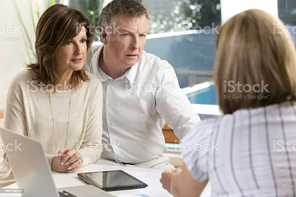 Worried mature Couple in Meeting With Advisor royalty-free stock photo