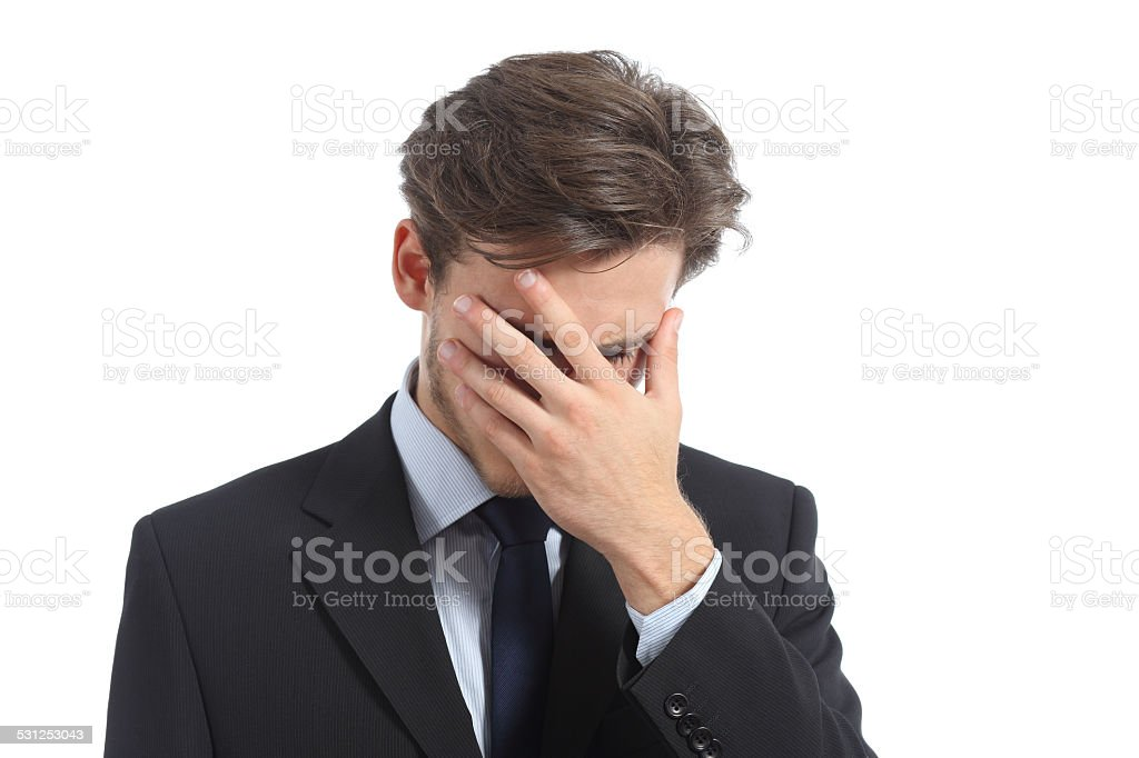 Worried or ashamed man covering his face with hand stock photo