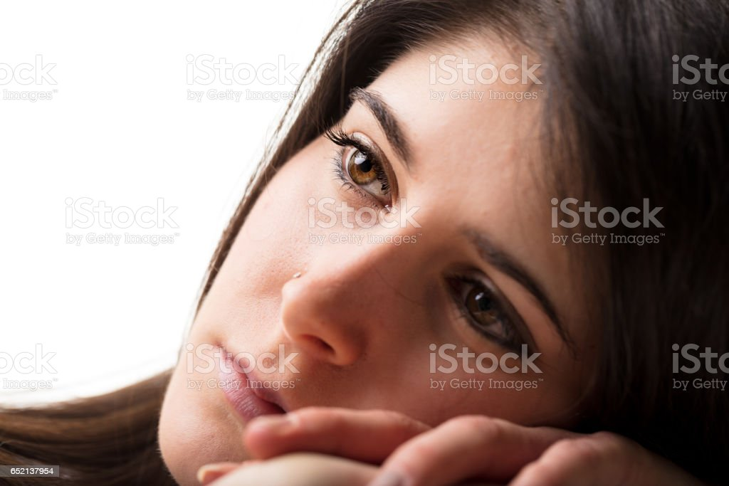 worried or dreaming thoughtful woman stock photo