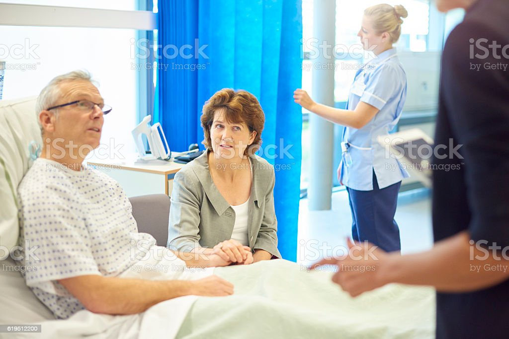 worried patient and wife waiting for news stock photo