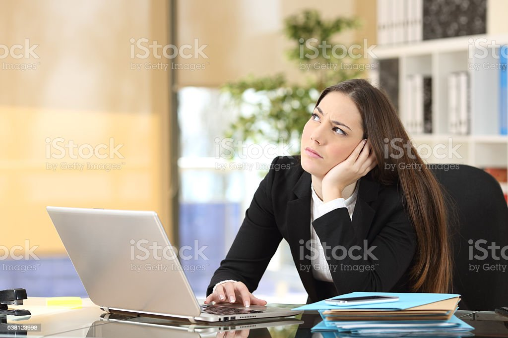 Worried pensive businesswoman at office stock photo