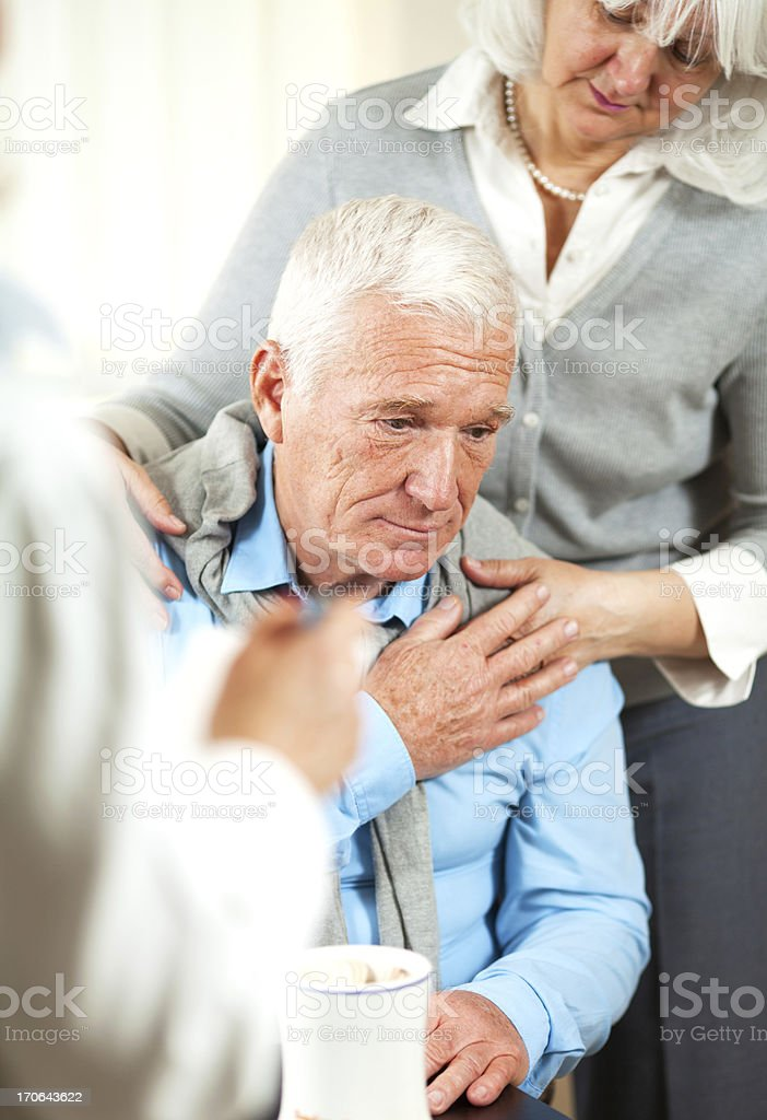 Worried senior couple at doctor's office royalty-free stock photo