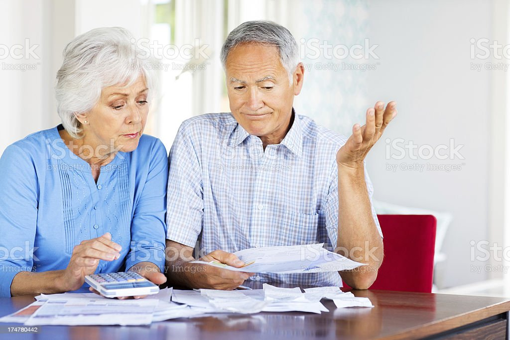 Worried Senior Couple Calculating Their Finances. royalty-free stock photo