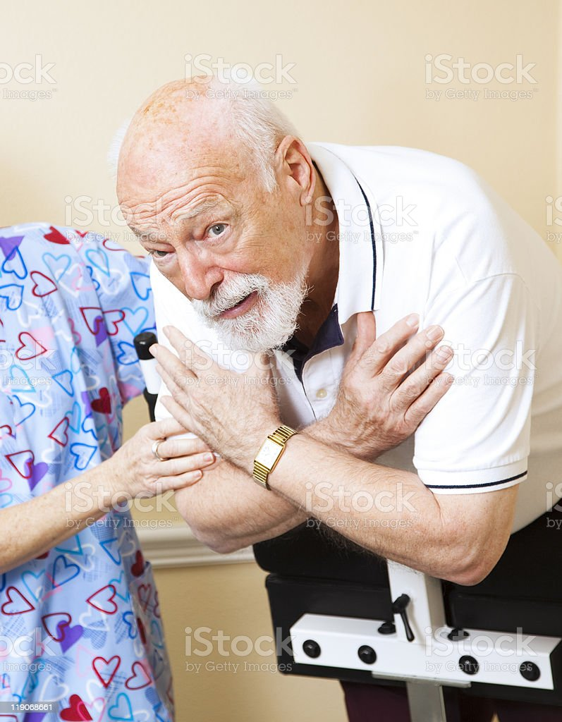 Worried Senior Doing Physical Therapy royalty-free stock photo