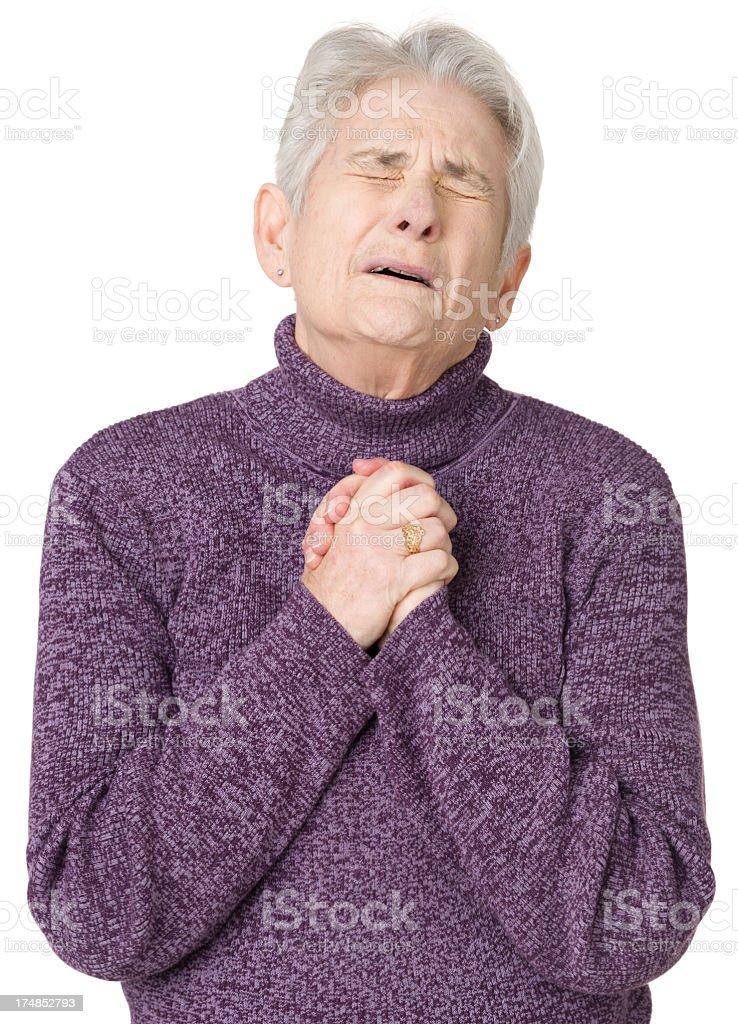 Worried Senior Woman Praying royalty-free stock photo