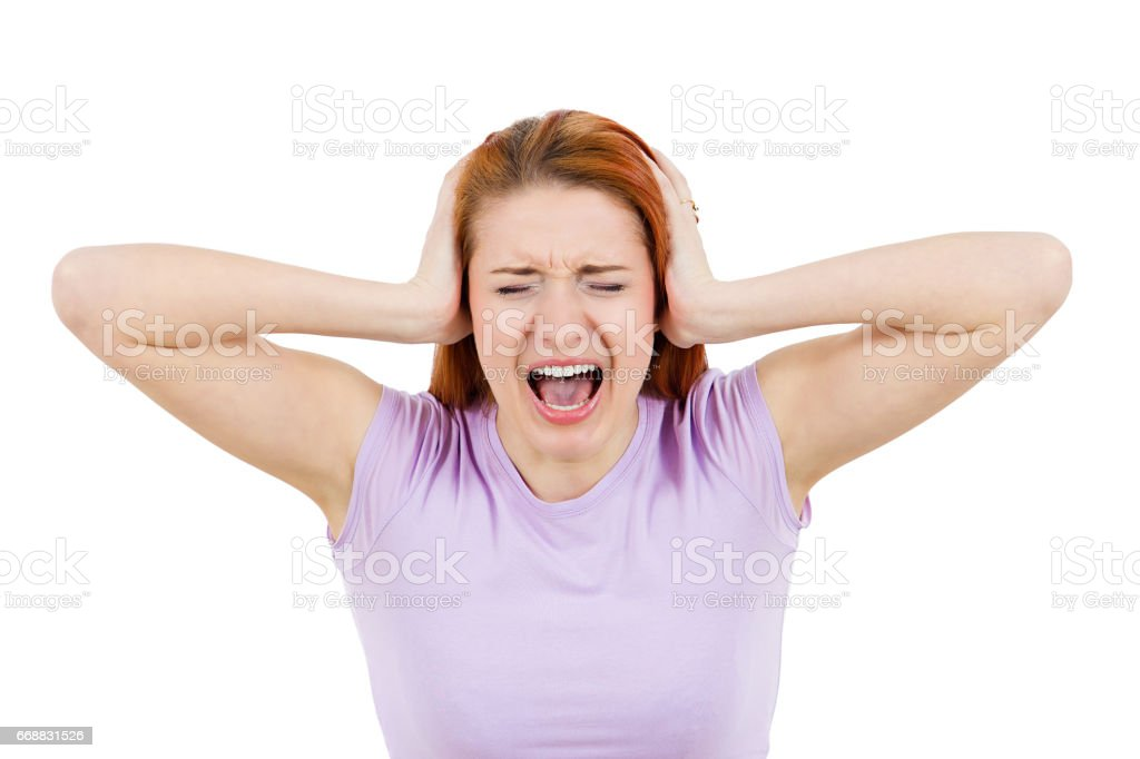 worried, stressed, overwhelmed young woman, funny looking girl, covering her ears, screaming stock photo