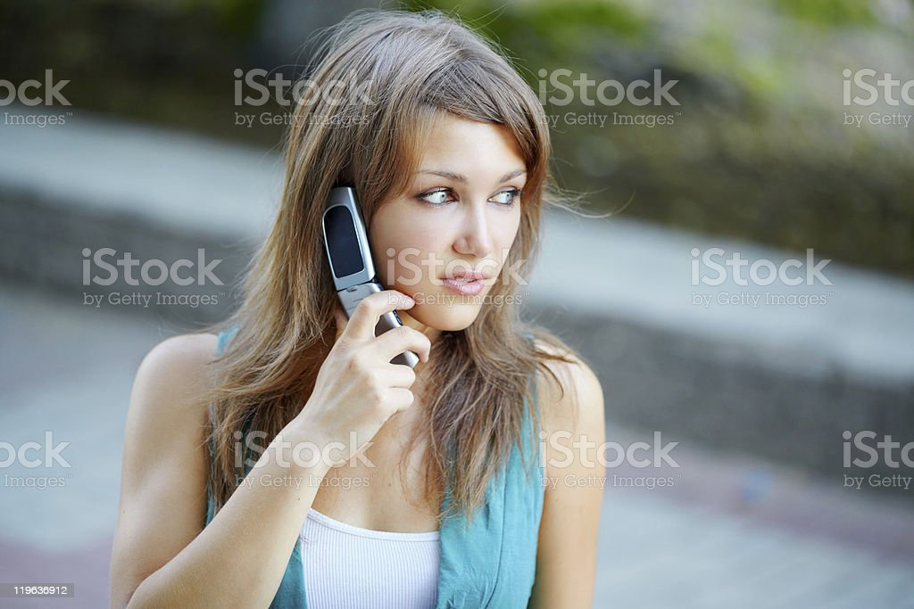 Worried teenage girl with talking by phone royalty-free stock photo