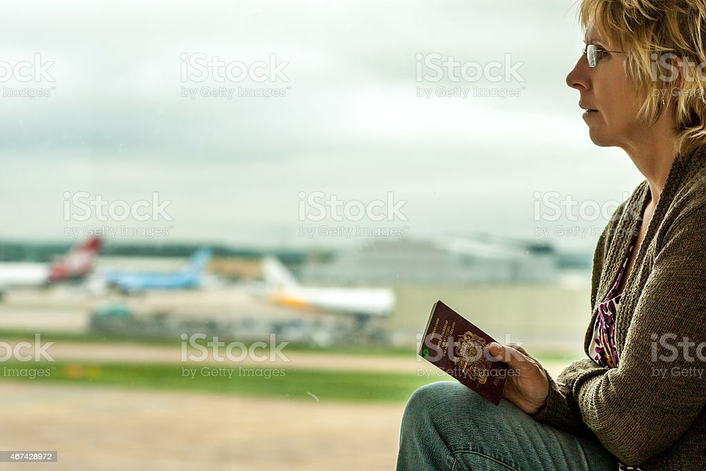 Worried woman air traveller at the airport stock photo