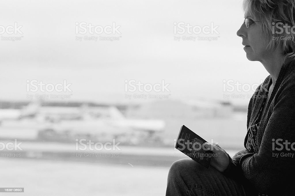 Worried woman at the airport royalty-free stock photo