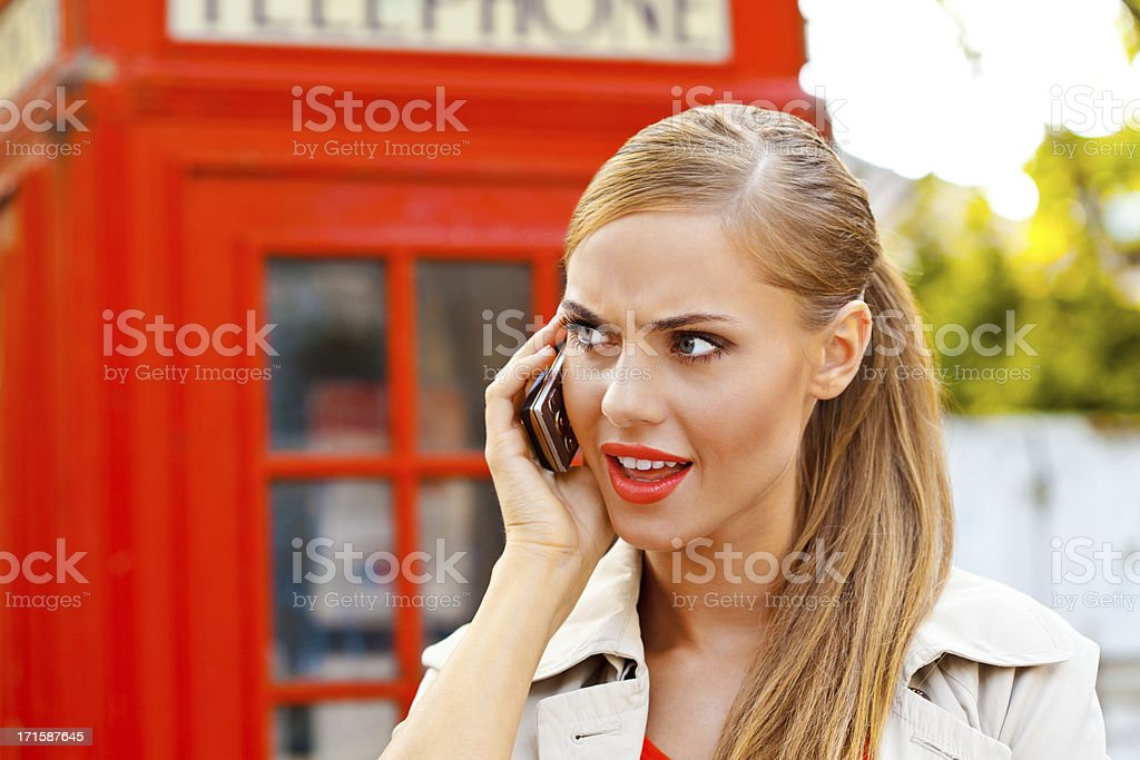 Worried woman on the phone royalty-free stock photo