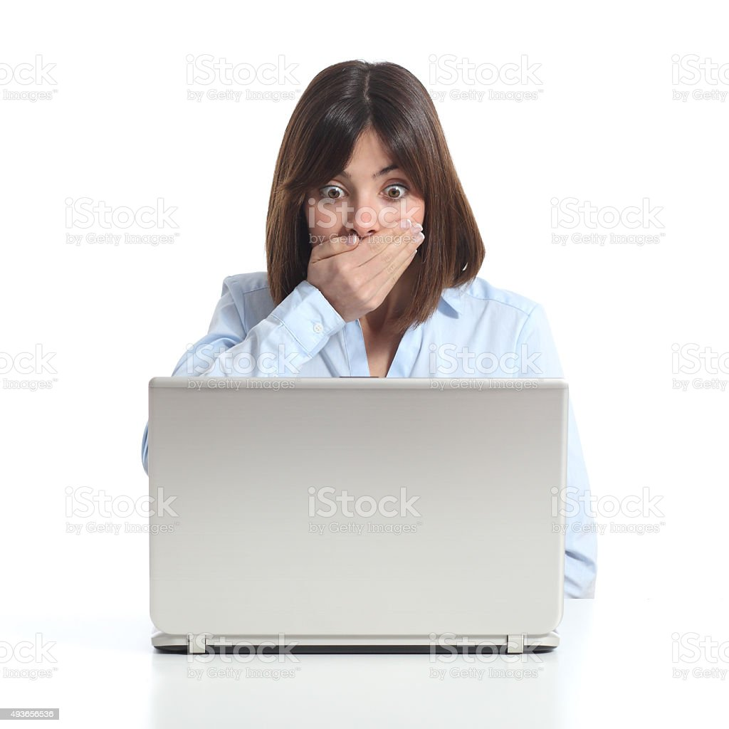 Worried woman watching a laptop stock photo