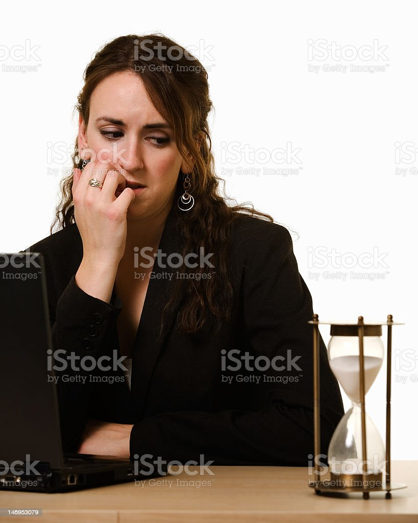 Worried woman Watching the clock royalty-free stock photo