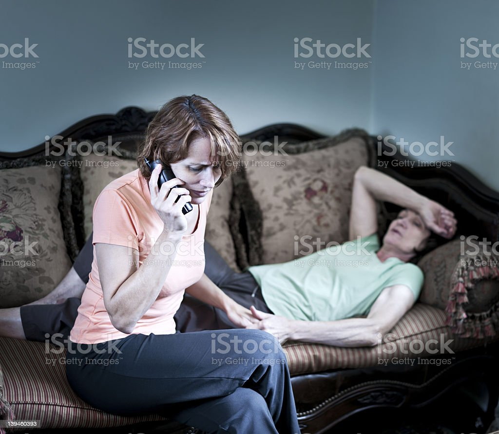 Worried woman with sick mother calling for help  royalty-free stock photo