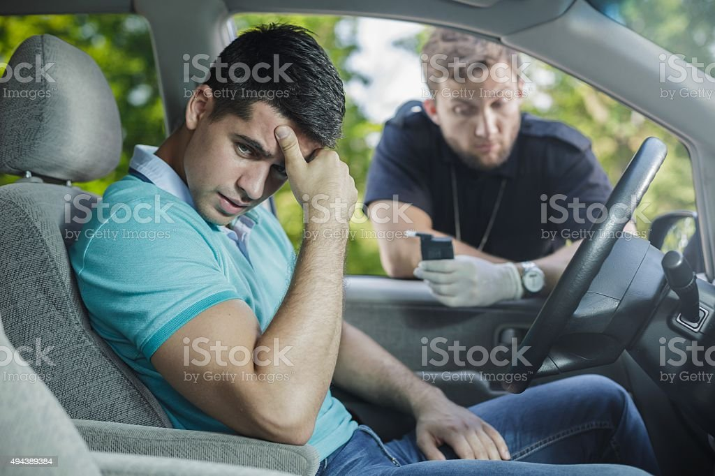 Worried young driver stock photo
