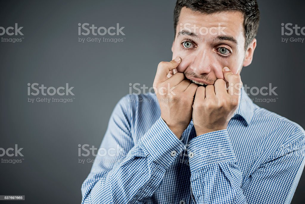 Worried young man stock photo