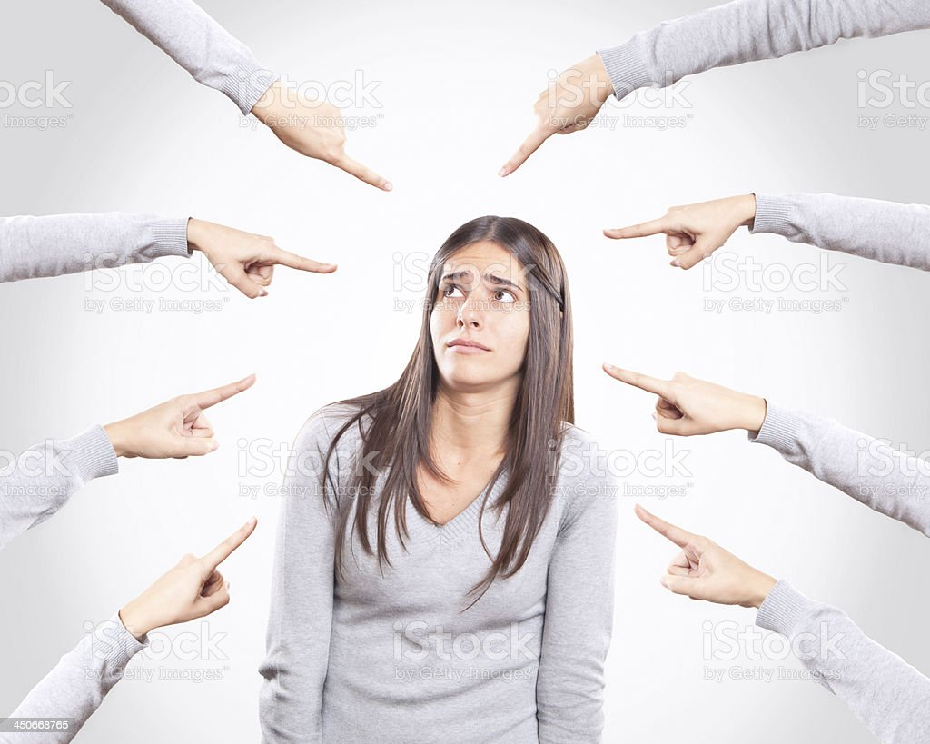 Worried young woman being accused stock photo