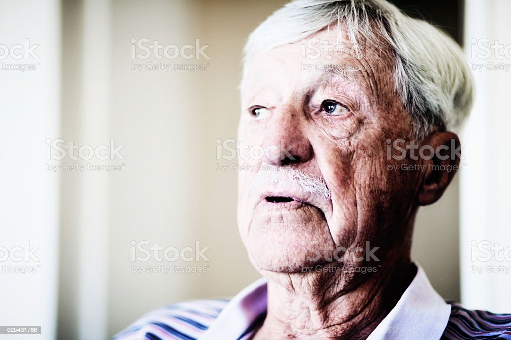 Worried-looking 90-year-old man seems confused stock photo