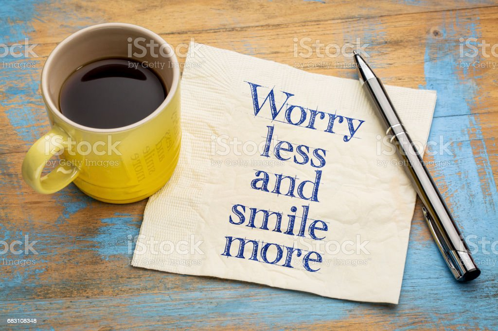 Worry less and smile more inspiraitonal text stock photo
