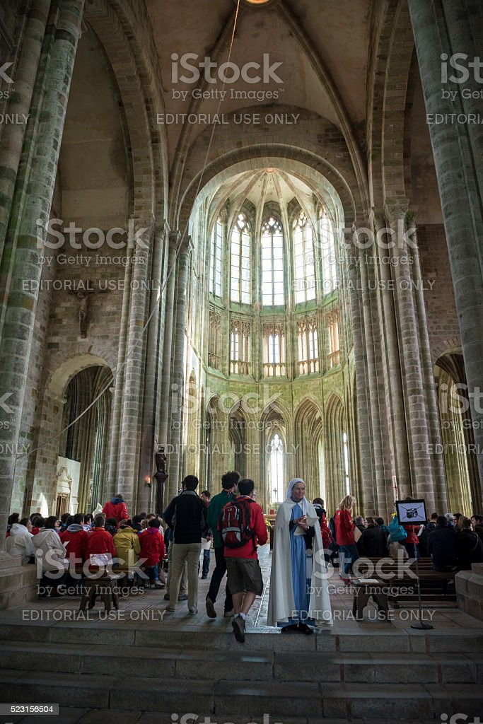 Worship at abbey church on Mont Saint-Michel, France stock photo