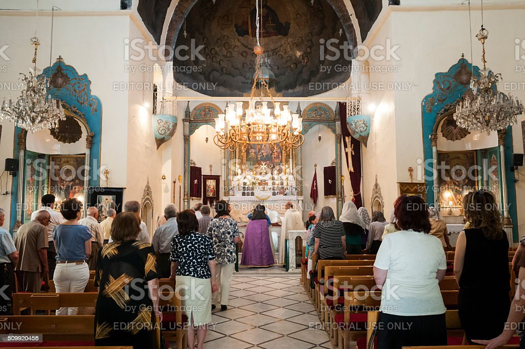 Worship inside Armenian church in Damascus, Syria stock photo