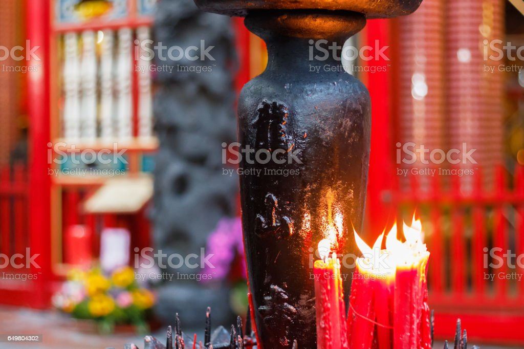Worship with red candles at Lungshan Temple stock photo