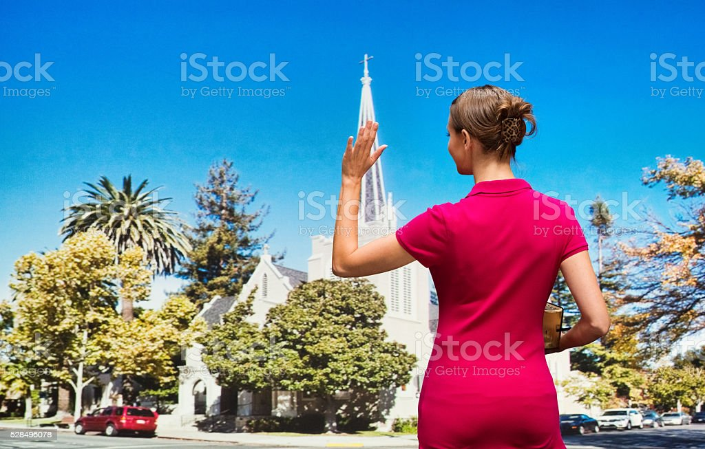 Worshiper waving hand stock photo