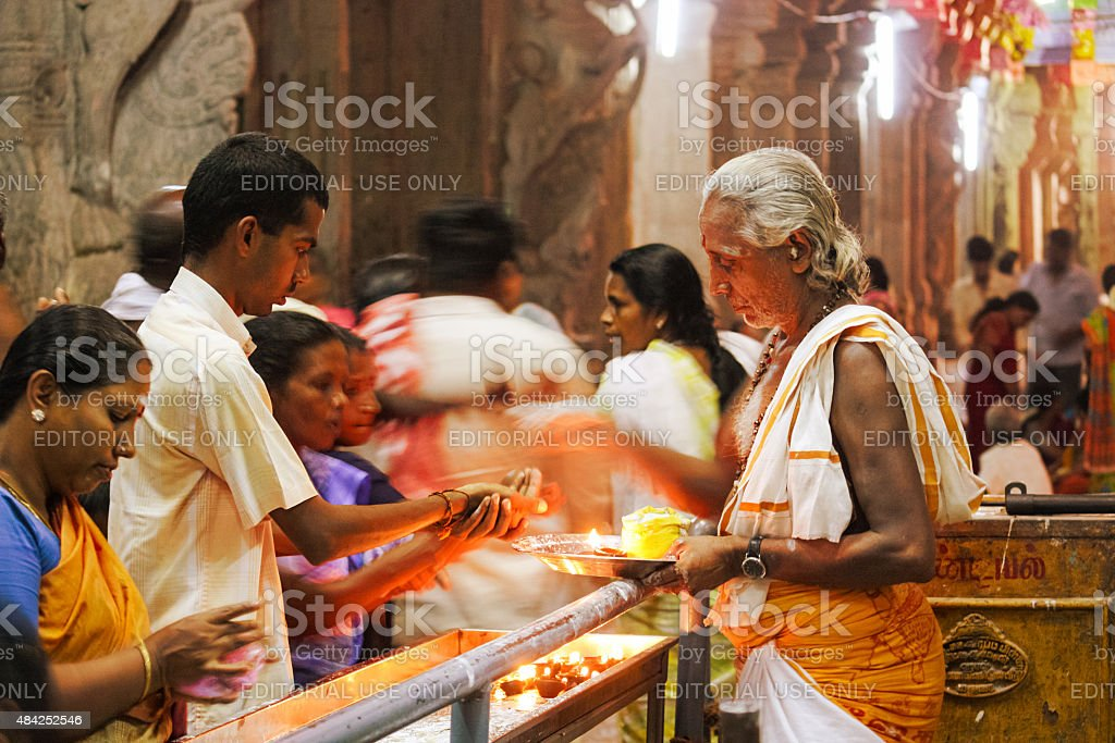 Worshipers at Meenakshi Amman Temple in Madurai India stock photo