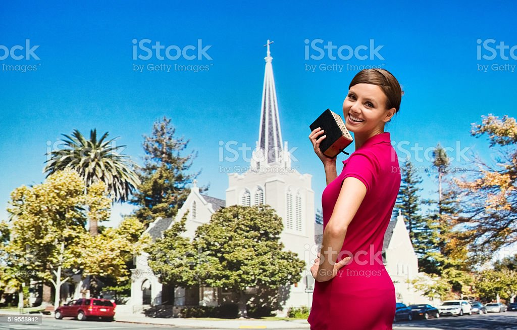 Worshipper attending church with bible in han stock photo