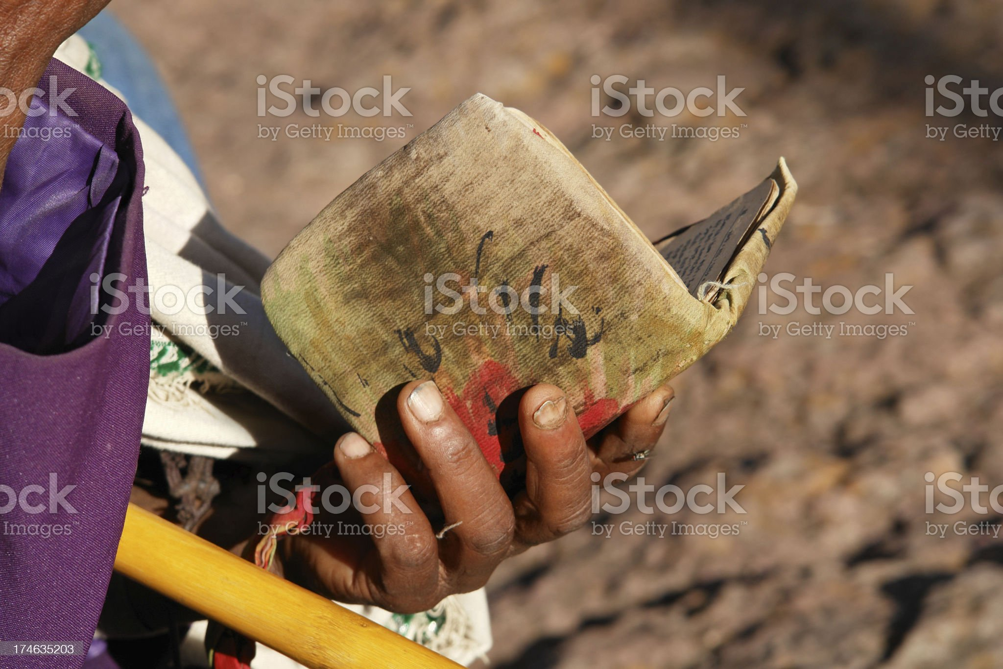 Worshipper Reading Holy Bible in Lalibela Ethiopia royalty-free stock photo