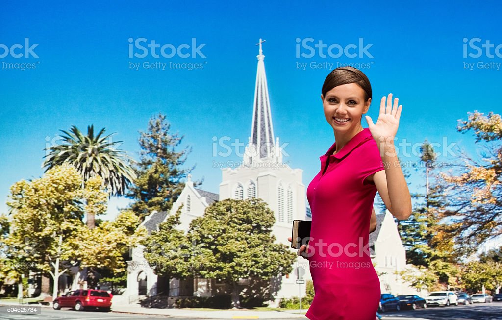 Worshipper waving hand outdoors stock photo