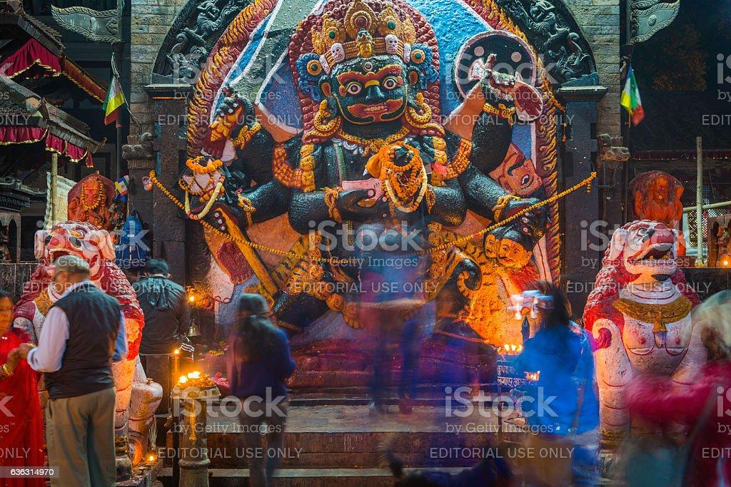 Worshippers at Bhairava Shiva Hindu shrine Durbar Square Kathmandu Nepal stock photo