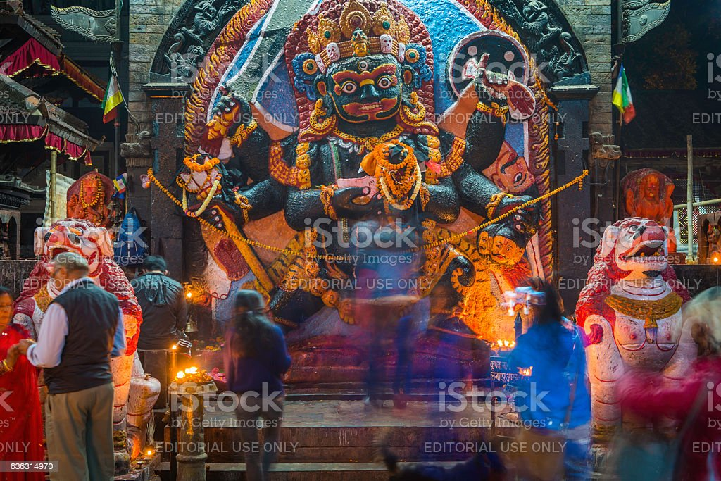 Worshippers at Bhairava Shiva Hindu shrine Durbar Square Kathmandu Nepal stock photo