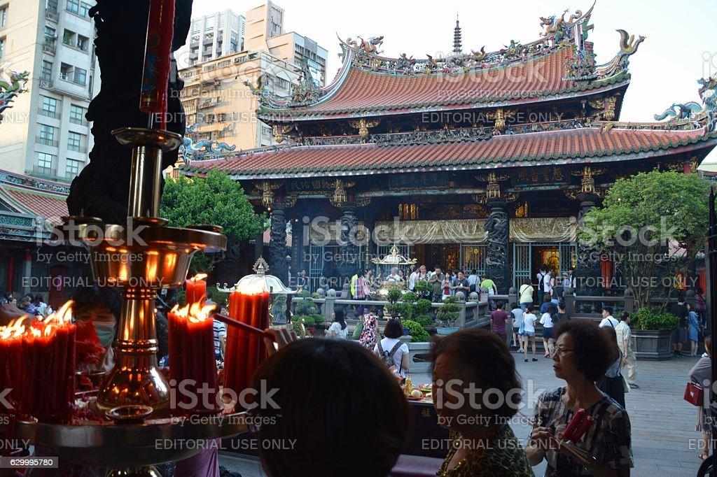 Worshippers at Longshan Temple, Taipei, Taiwan stock photo