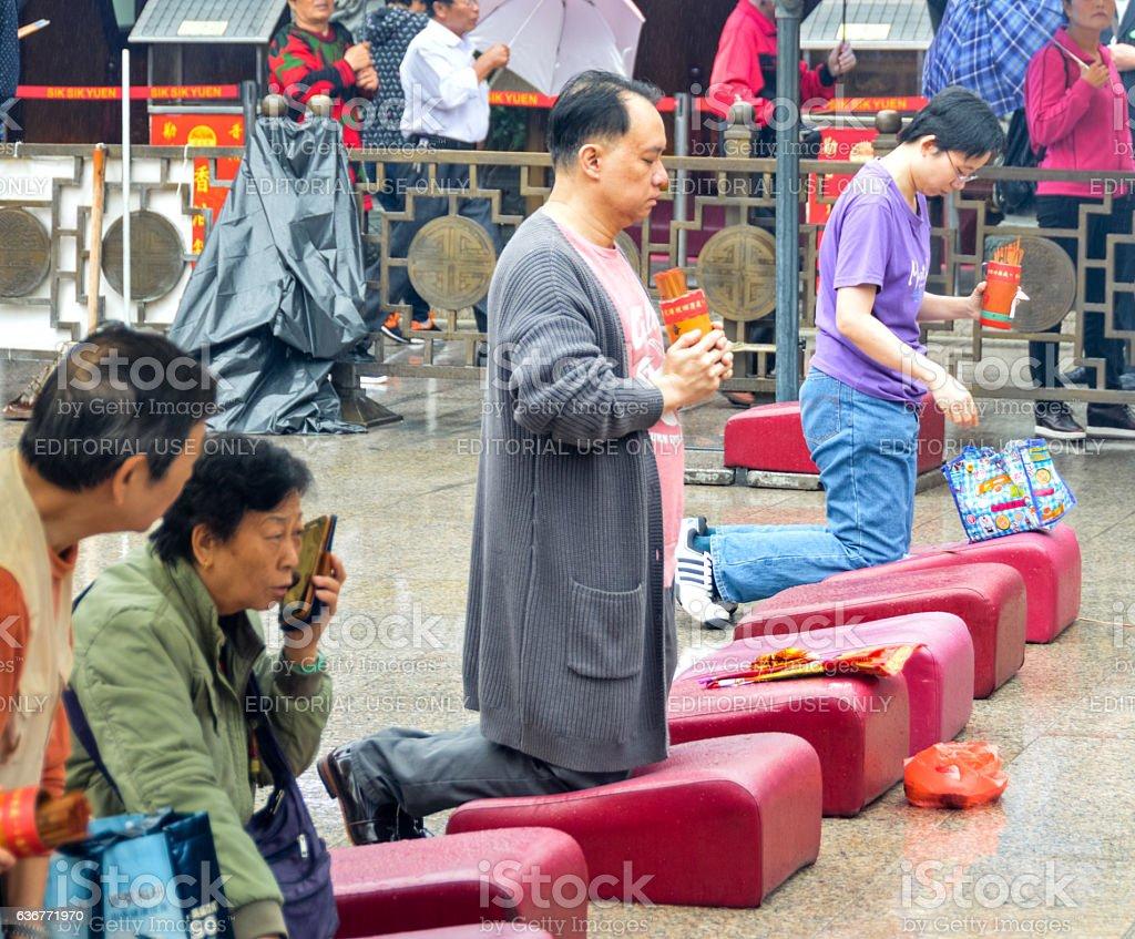 Worshippers at Wong Tai Sin temple in Hong Kong stock photo