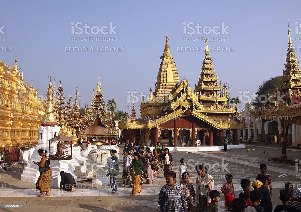 worshippers in Shwezigon Pagoda royalty-free stock photo
