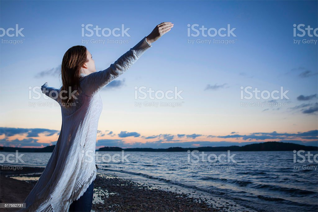 Worshipping girl stock photo
