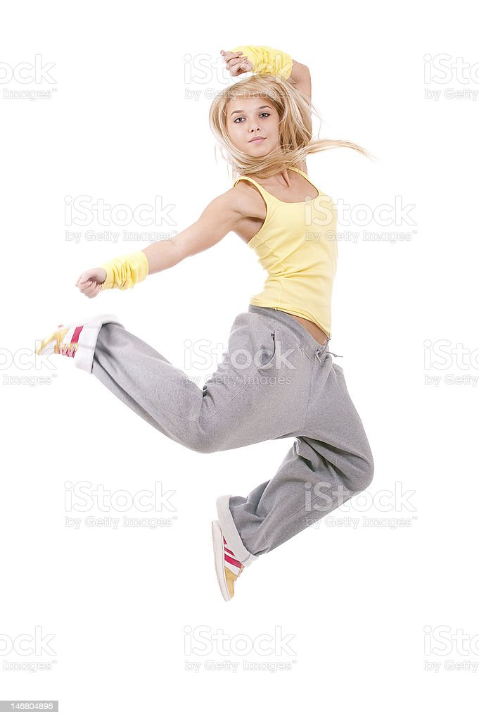 A wound sportswoman jumping and striking a pose royalty-free stock photo