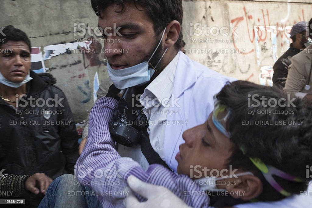 Wounded egyptian boy in Tahrir square royalty-free stock photo