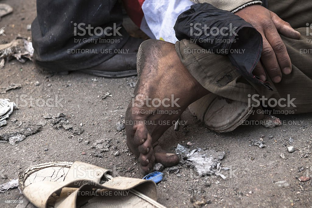 Wounded egyptian man lies on the ground stock photo