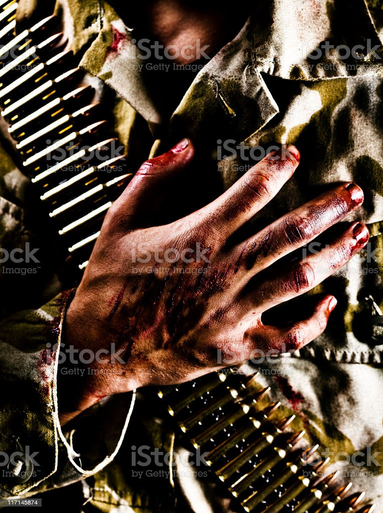 Wounded Soldier with Hand on Heart stock photo